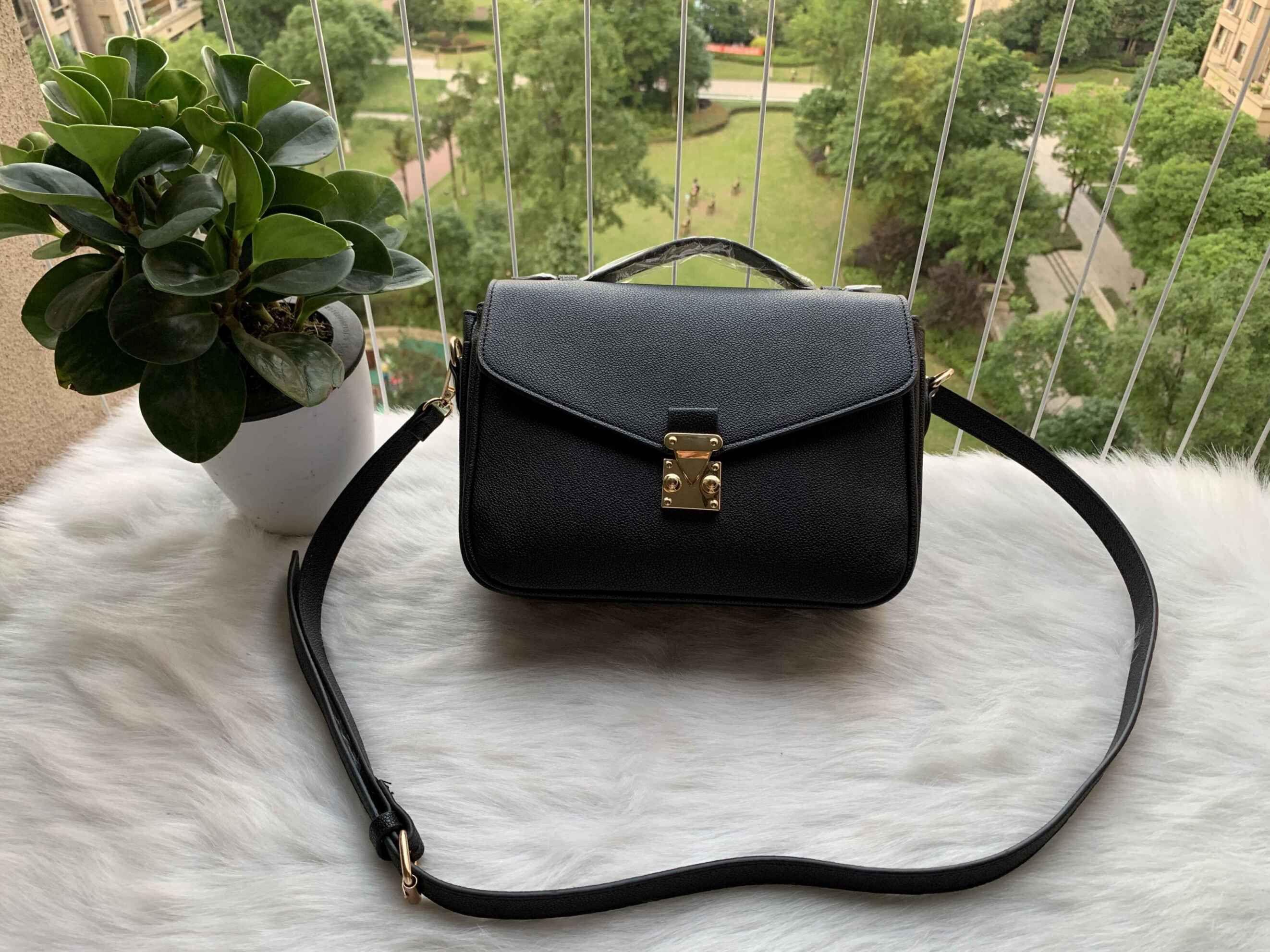 Подлинная бесплатная сумочка качество 2021 тиснение черные женские сумки высокой доставкой кожаные сумки через плечо мешок сумка fxhnc