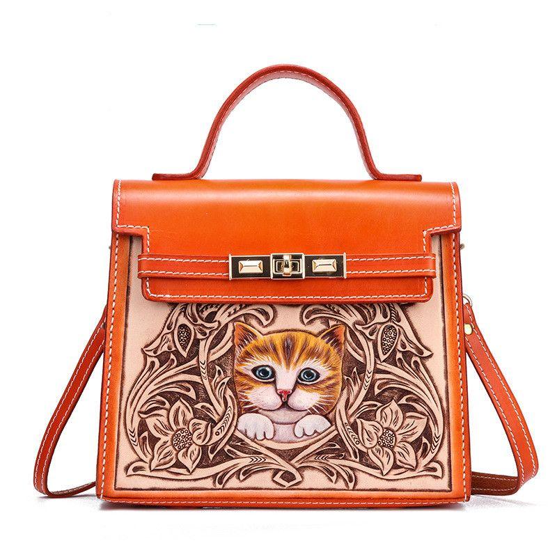 Handgemachte Blumen Kuhfell Geschnitzte Luxus-Handtaschen Cat Frauen-Beutel-Designer 2020 Chinese Taschen