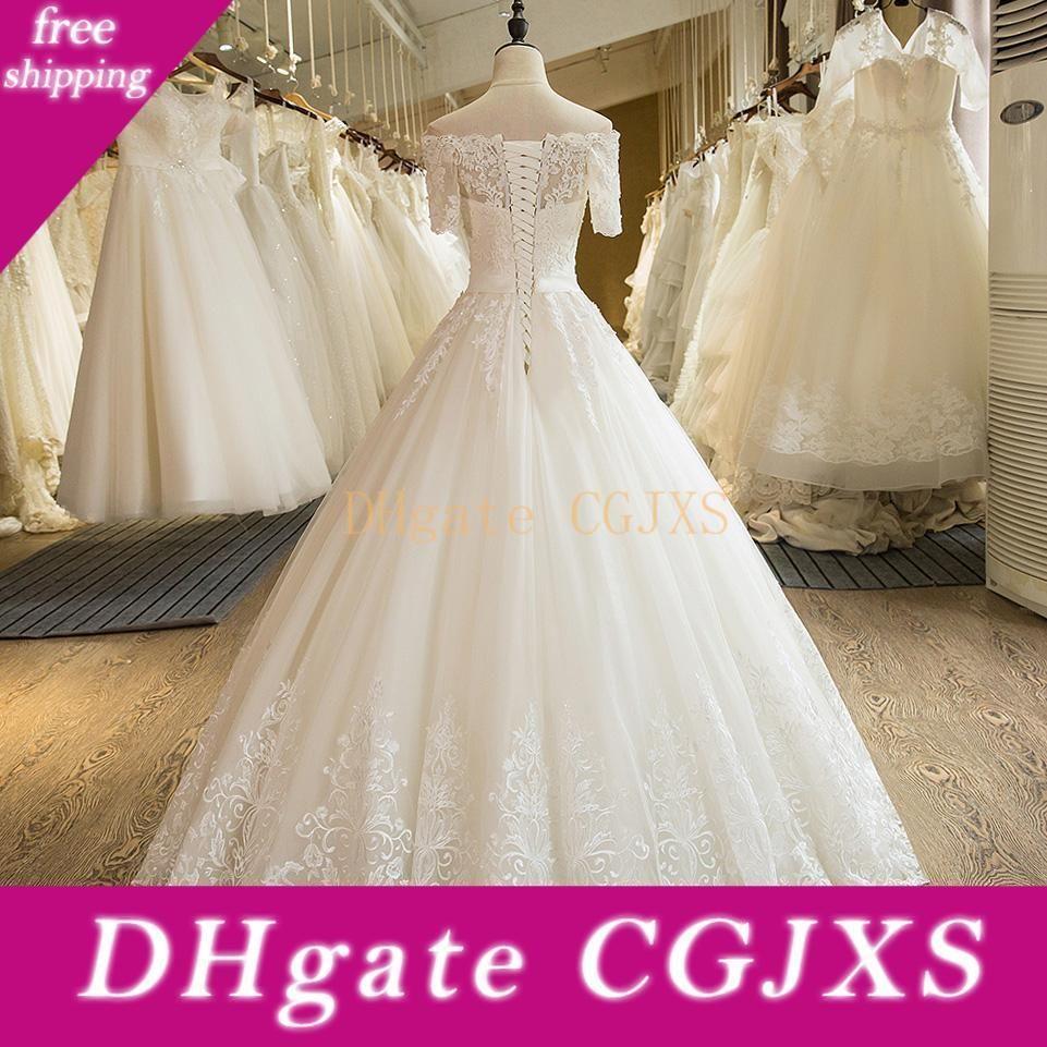 Casamento real vestidos meia luva A Linha Lace Voltar Piso -Comprimento apliques de renda princesa loja noiva árabe vestido nupcial vestidos de casamento