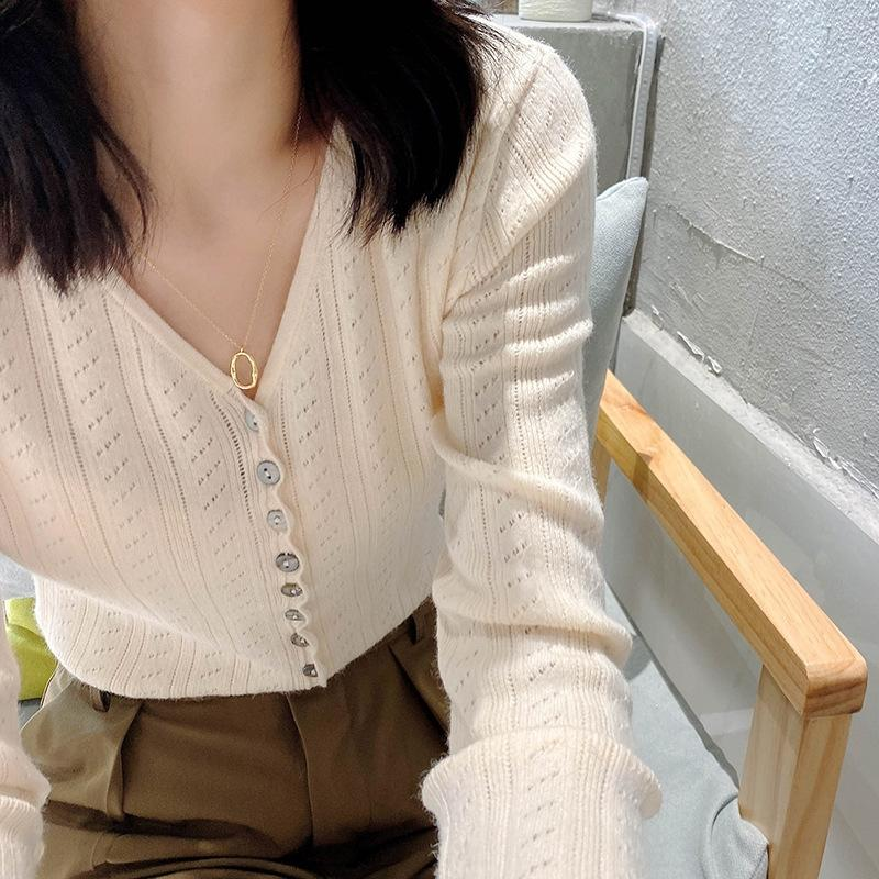 E6R8C Schwarzer Reis Hafer hohler Oat Strickwaren V-Ausschnitt Langarm-Strickwaren der Frauen 2020 Herbst der neue koreanische Art beiläufiger Strickjacke