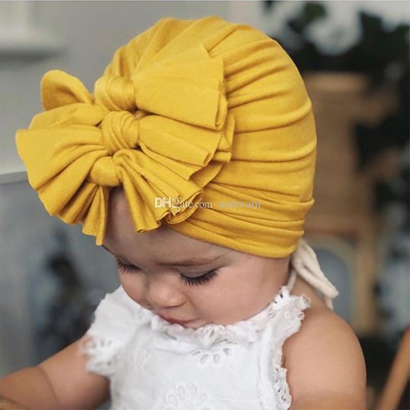 colore solido cappelli del bambino di Bowknot Turbante Cappello Turbante Bun Knot infantile del Beanie della neonata sveglia molle Bambino PAC e il dono di sabbia
