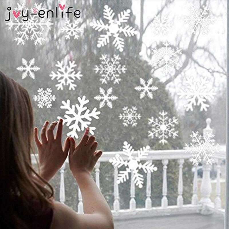 27pcs / lot bianco del fiocco di neve Glass Sticker Camera Finestra Natale dei capretti muro Adesivi decalcomanie domestiche Decorazione di Capodanno 2020