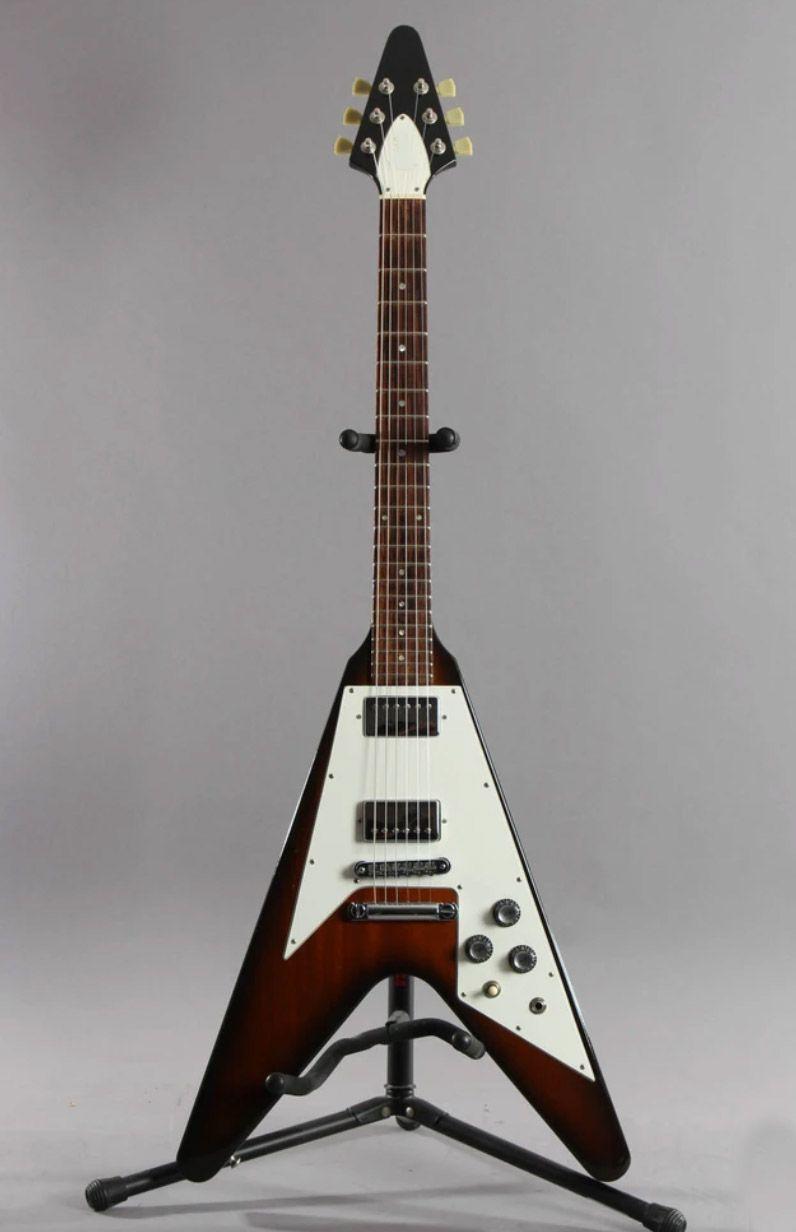 Guitarra eléctrica de calidad con guitarra voladora