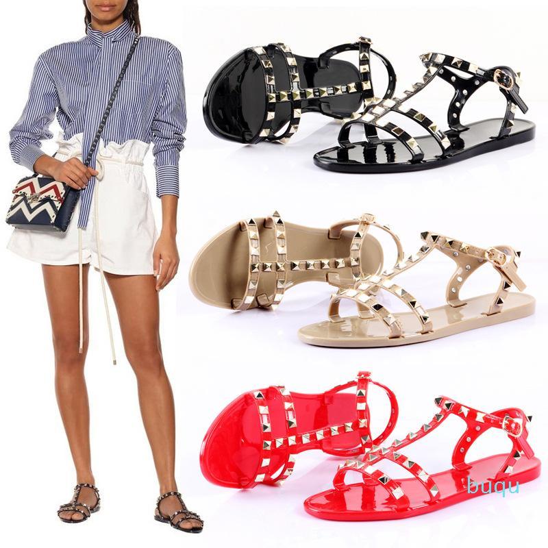 Sıcak satış-Kadın sandalet jöle düz yaz düz ayakkabılar bantlı damızlık su geçirmez plaj ayakkabıları perçin çivili fegrated
