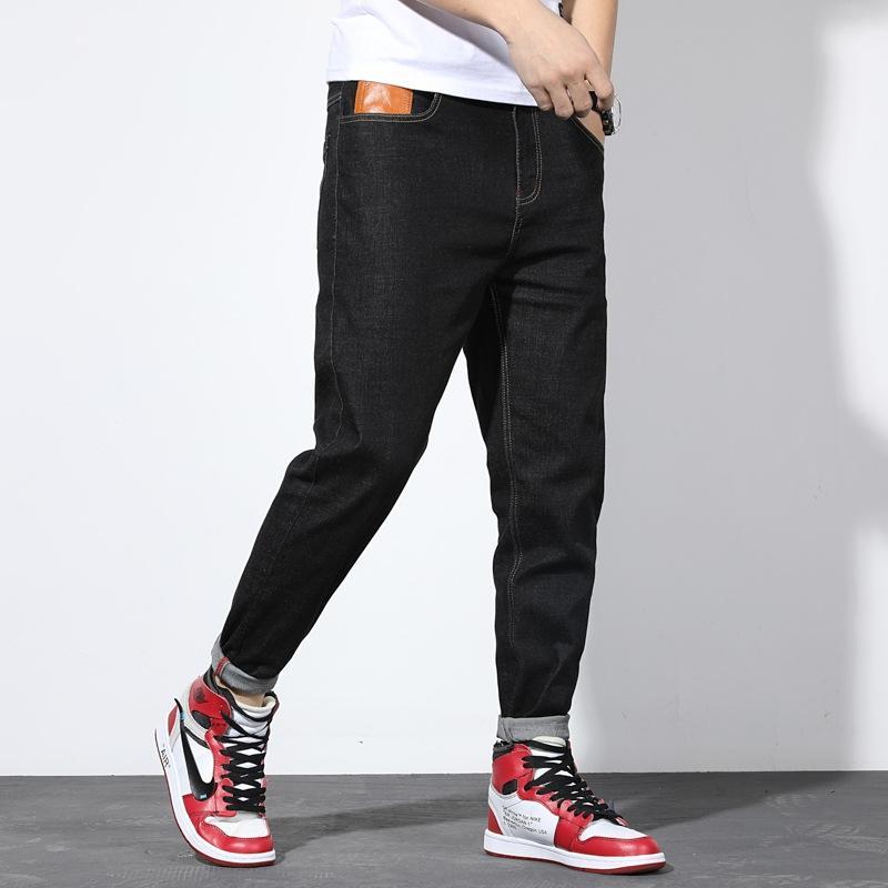El otoño y el invierno negro lavados manera ocasional pequeños pies pantalones vaqueros y los pantalones vaqueros de los pantalones del harem de los hombres más gordos pantalones de gran tamaño de los hombres