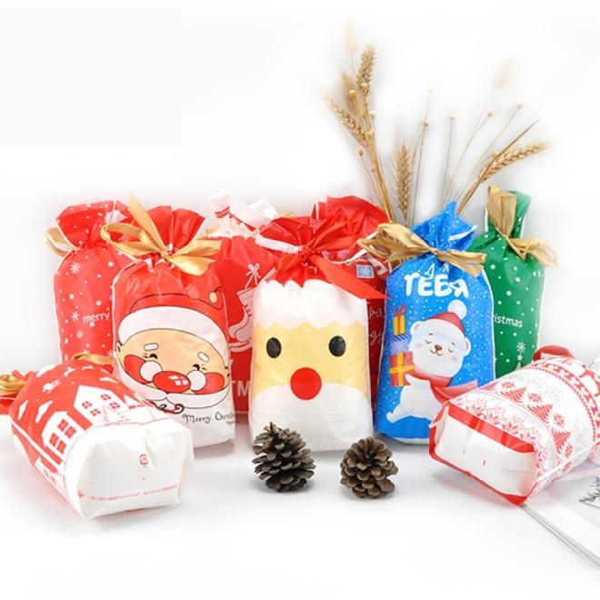 حقائب 50PCS عيد ميلاد سعيد هدية أكياس بلاستيكية كاندي الكوكيز حقائب هدية عيد الميلاد شجرة الحلوى مع وجبة خفيفة الشريط البسكويت الخبز حزمة