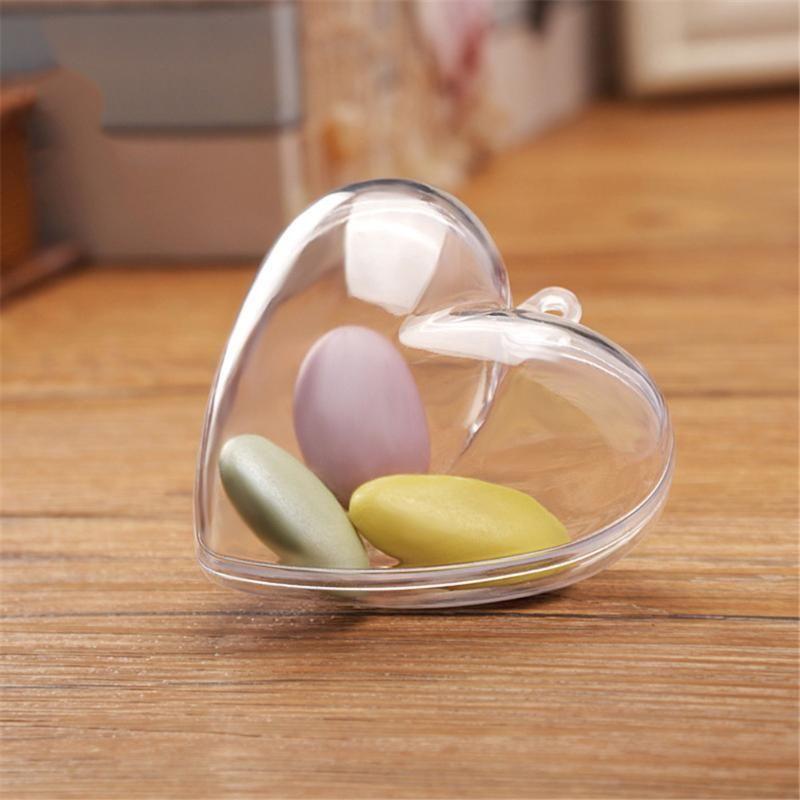 La venta caliente 1PCS forma transparente de plástico transparente de amor del corazón de la bola de la caja del caramelo para el árbol de Navidad Colgante Festival de decoración decoración de la boda