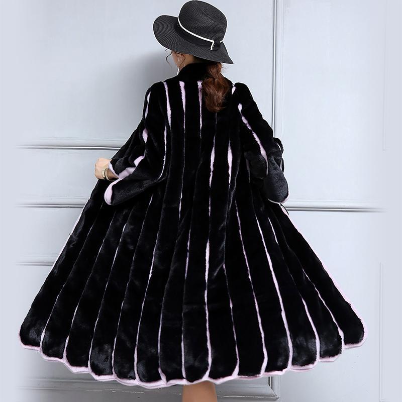 Manteau de fourrure du nouveau fonds de 2020 hivers d'automne est épissage de fourrure artificielle femme bande col manteau d'hiver à long imitation