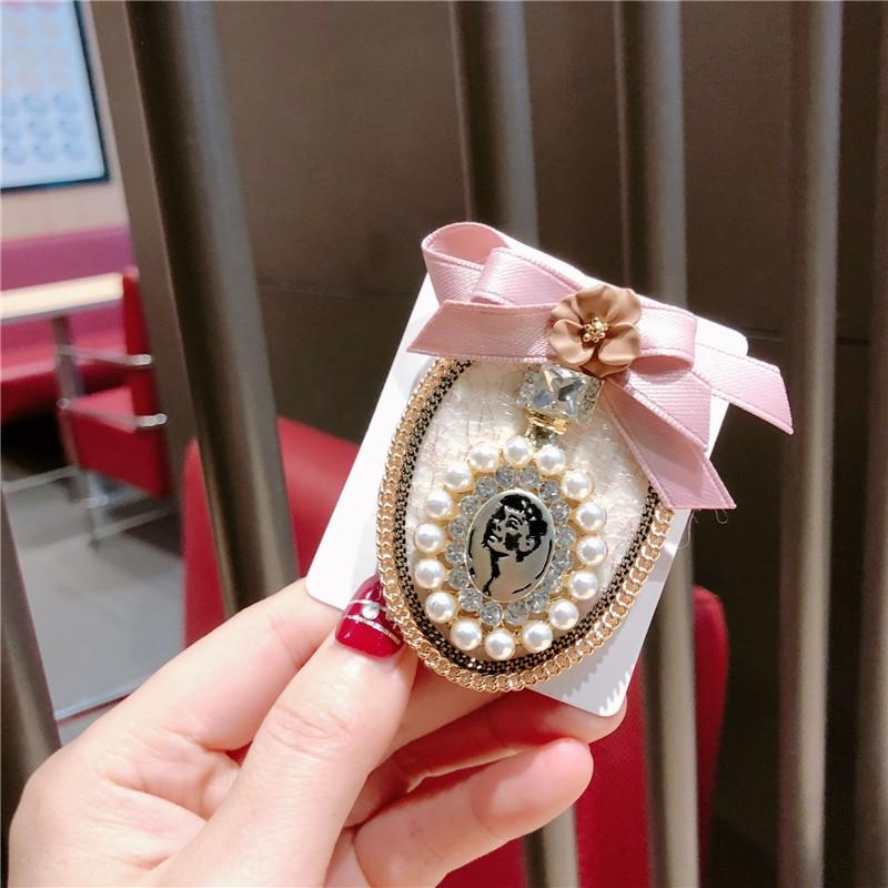 gjPIb Fashion black and Accessories perfume bottle white bow perfume bottle pearl flower ring brooch fashion accessories production
