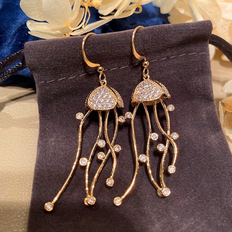 BhQlH en haute mer méduses enroulement oreille et boucles d'oreilles crochet boucles méduses pompon haut de gamme smart visage femmes fil de l'oreille mince élégante