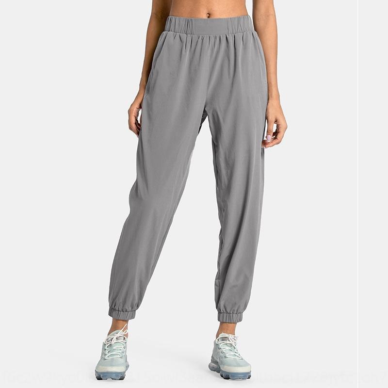 tasca 2020 gamba vincolante allentato casuale delle donne in esecuzione tubo diritto ad asciugatura rapida Yoga esterna di fitness che coprono il vestito di yoga pantaloni sportivi sport