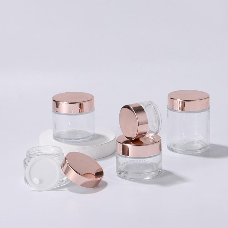 Klarglas-Creme Flaschen Runde Cosmetic Hand Gesicht Jar 5g 10g 15g 20g 30g 50g 60g 100g Verpackung Flaschen mit glänzendem Gold Cap