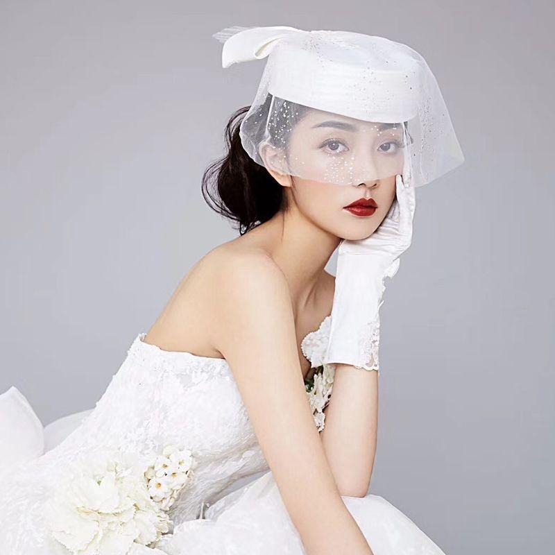 Frauen-elegante weiße große Bowknot Schleier Fascinator Hut Cocktail Cap Dame Hochzeit Pillbox-Hut Fedora Haar Accessorie