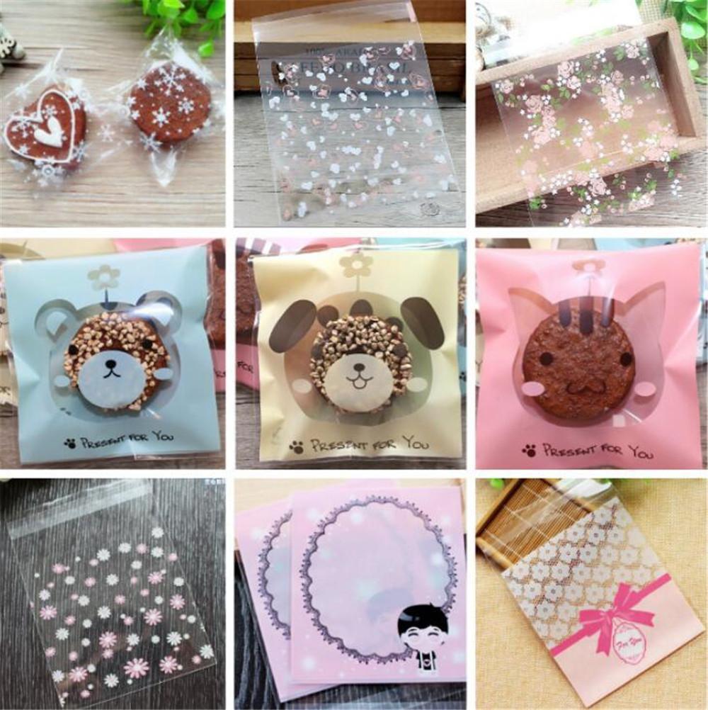100 PC / porción plástica linda de la fiesta de cumpleaños de la boda bolsa favores de la galleta bolsas de regalo de empaquetado del auto-adhesivo de la bolsa de los bolsos del caramelo