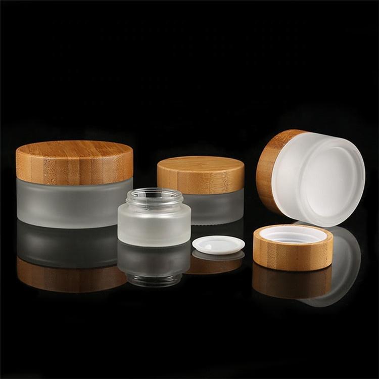 50pcs * 50pcs * 100g 50g + bambú frasco de vidrio cosmética para la cara crema de embalaje frasco de vidrio con tapa de bambú de bambú botella clara helada