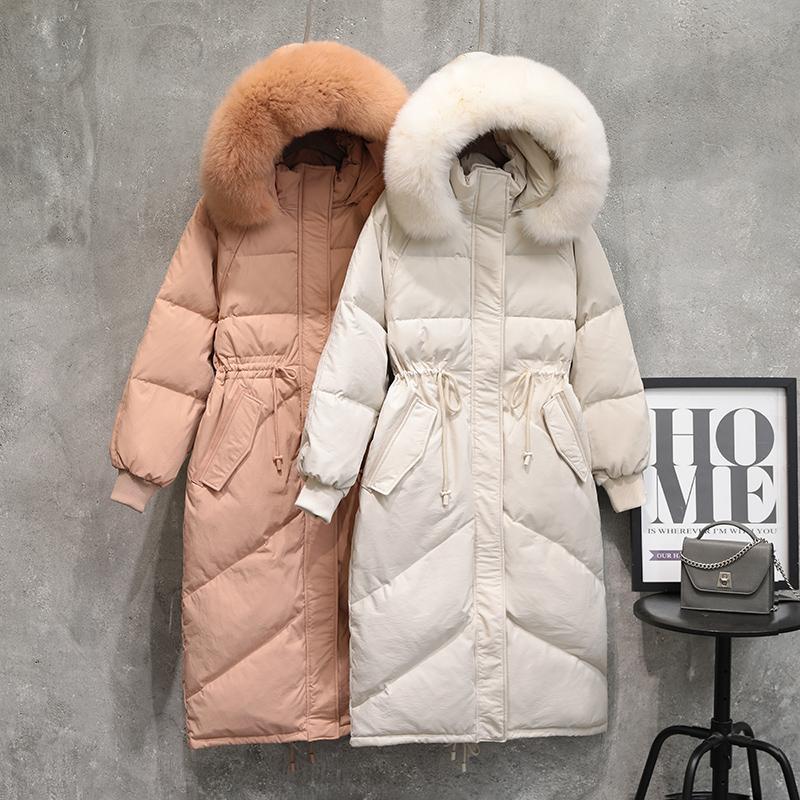 Además del revestimiento de apresto X-larga de la chaqueta de las mujeres abajo 2020 nueva piel real estilo caliente con capucha pato blanco cálido continua gruesa elegante