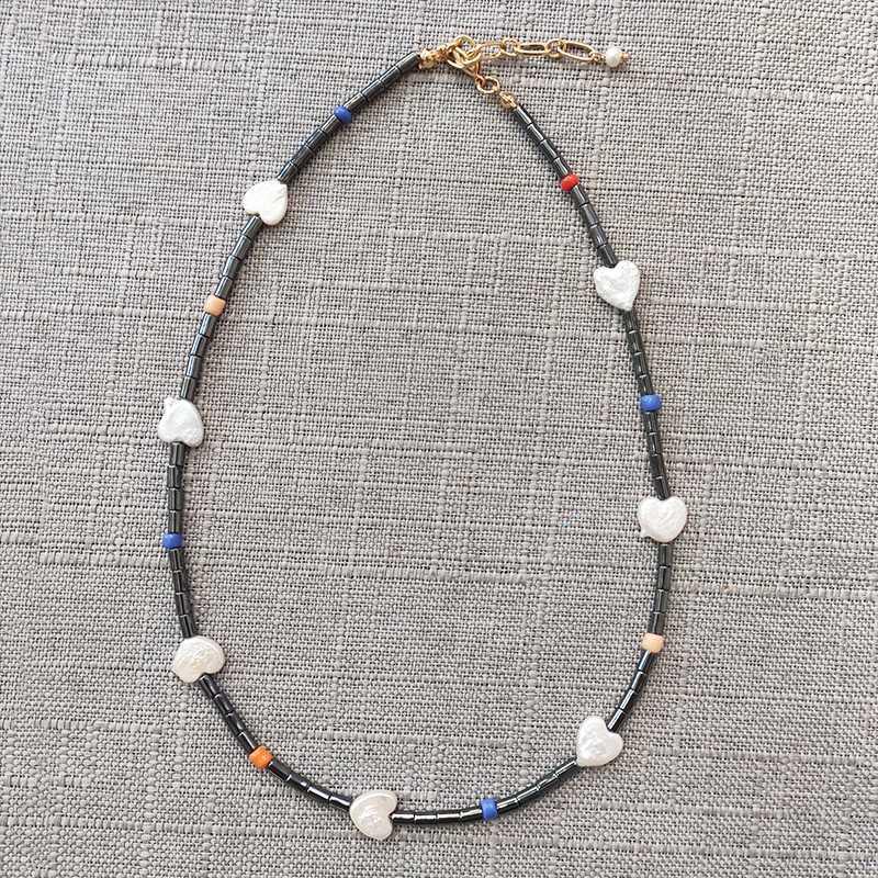 Punk collana di pietra nera stile boho a mano a forma di cuore perle uomini e le donne d'avanguardia dei monili lunga collana regolabili