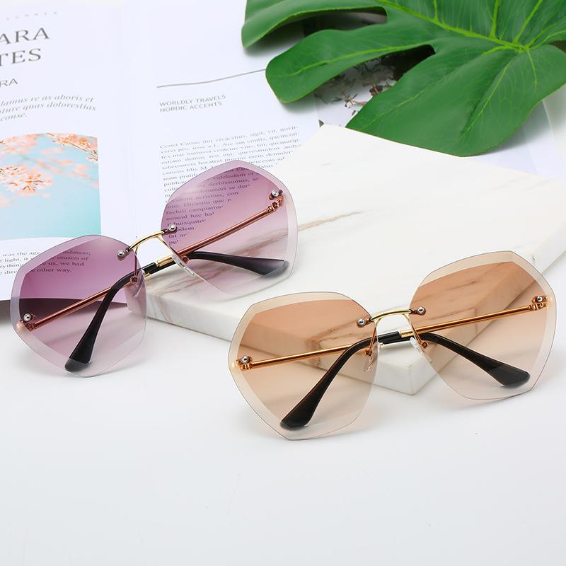 Rahmenlose weibliche Farbverlaufs-Sonnenbrille Ozean-Brillengeschnimmter Polygon-Film Neue Farbe Frauen Damen Gqign
