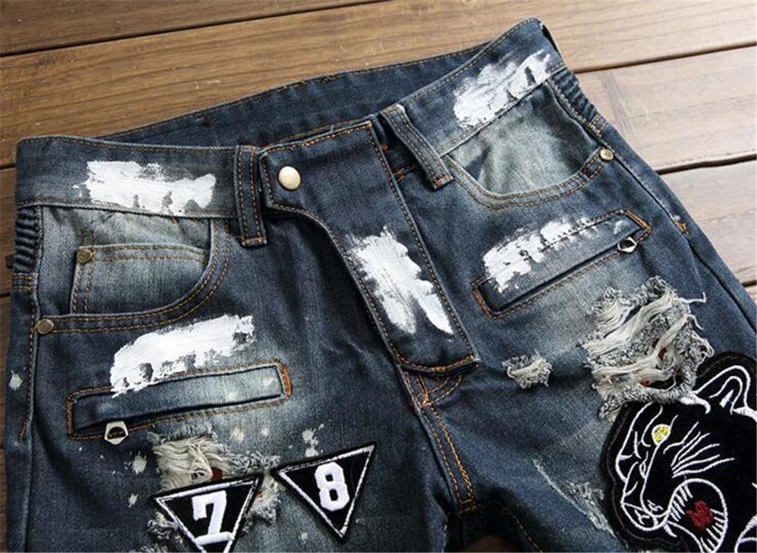 Vente Hot mens Street Style Jeans de haute qualité Hip Hop Blue Hole Jeans de haute qualité pour hommes de personnalité Straight serrés du commerce extérieur