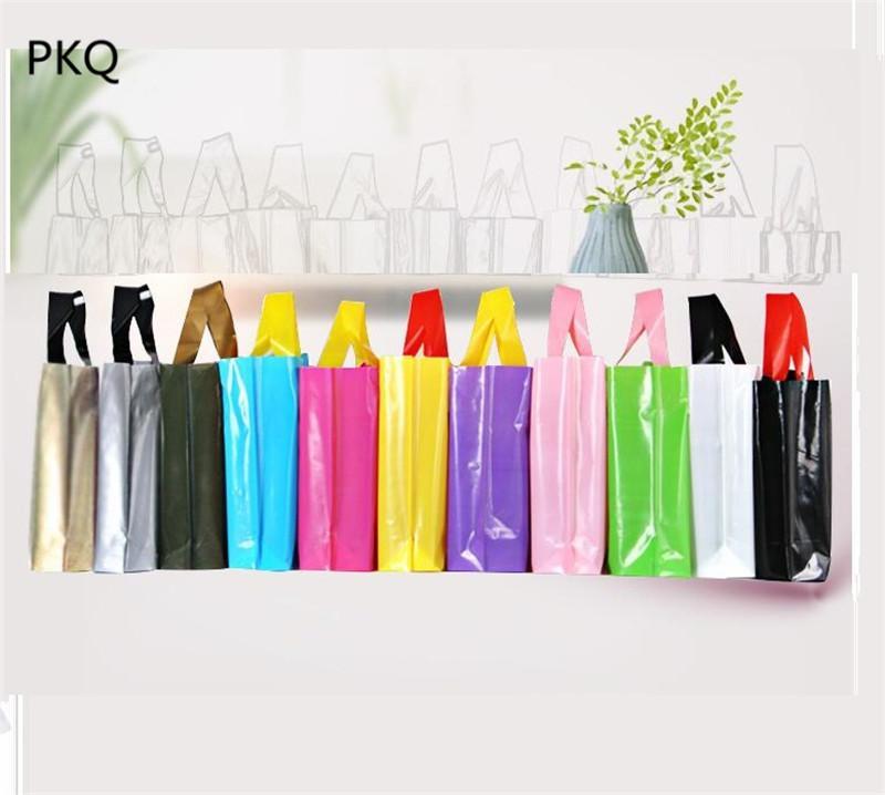 35 * 25 cm de bricolaje de impresión del logotipo de plástico bolsas de regalo para la ropa interior de la camiseta púrpura cosméticos Embalaje de plástico Bolso de compras con handl