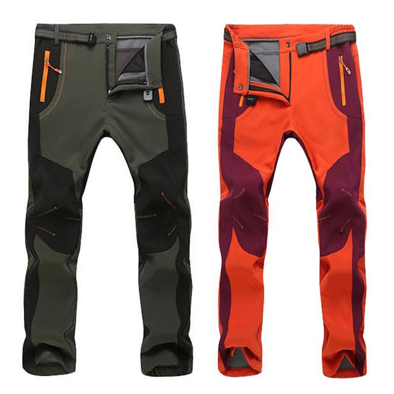 Pantalones de invierno de estiramiento pantalones ocasionales de los hombres de las mujeres paño grueso y suave de Carga Shell impermeable pantalones de trabajo caliente grueso pantalón 5XL