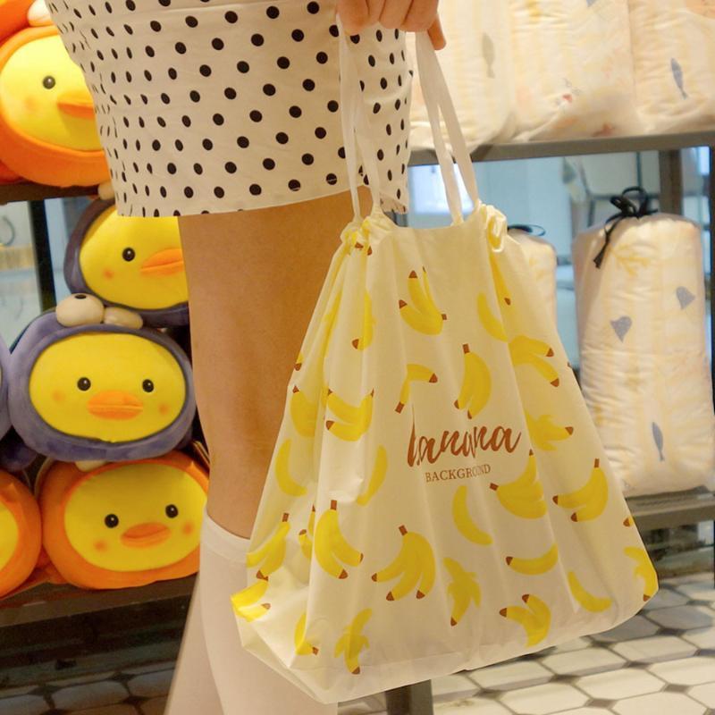 50pcs Schnür-Geschenk-Beutel Banana Pattern-Verpackungs-Beutel wasserdichte Einkaufstasche