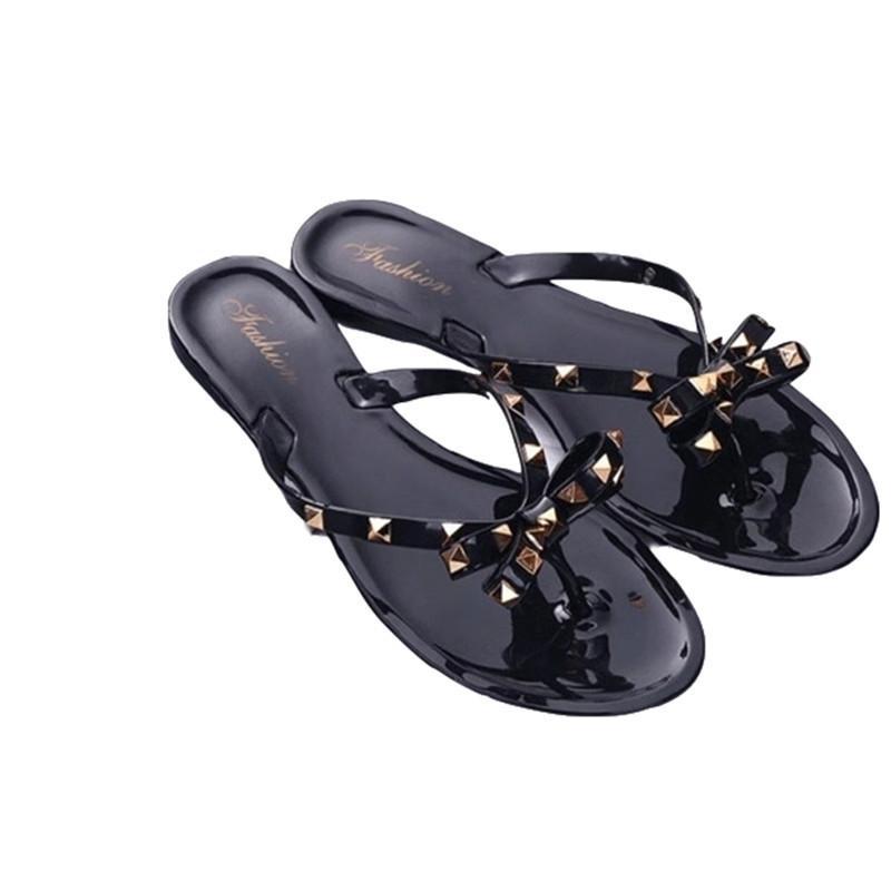2019 nouvelles pantoufles été femme arc rivet mode tongs chaussures gelée usure plates sauvages sandales et pantoufles Y200620