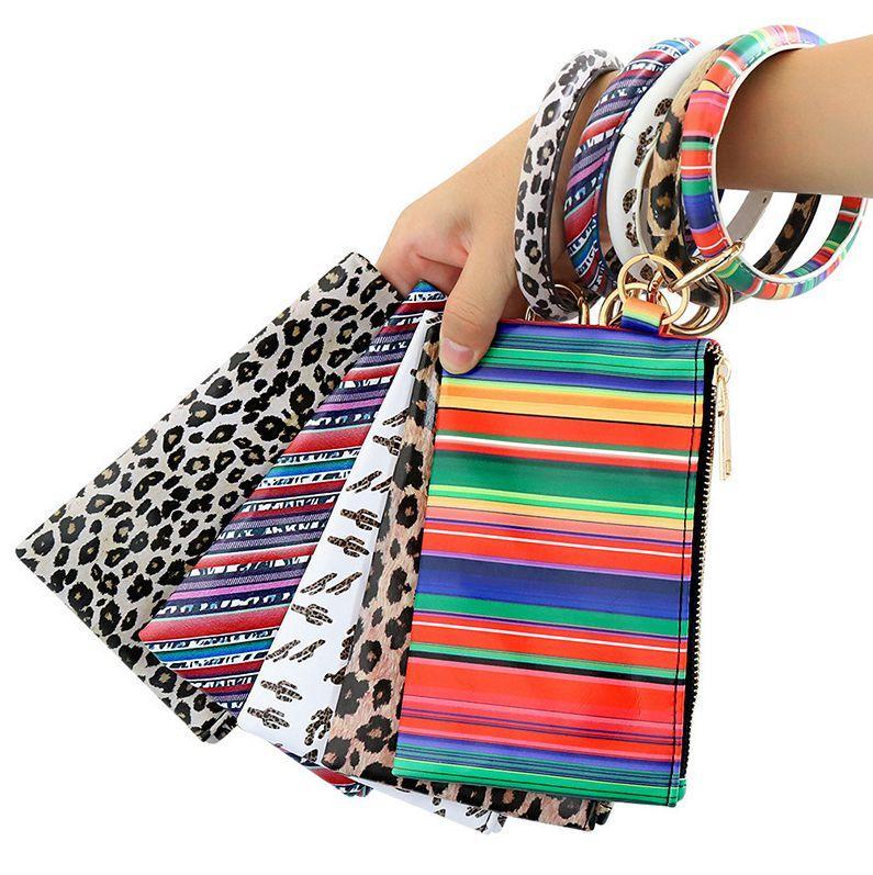 PU-Schlüsselanhänger-Armband-Mappen-Leder-Troddel-hängende Handtasche Leopard Sonnenblume-Druck-Armband-Dame-Beutel-Geschenk-Partei-Bevorzugung OOA9134