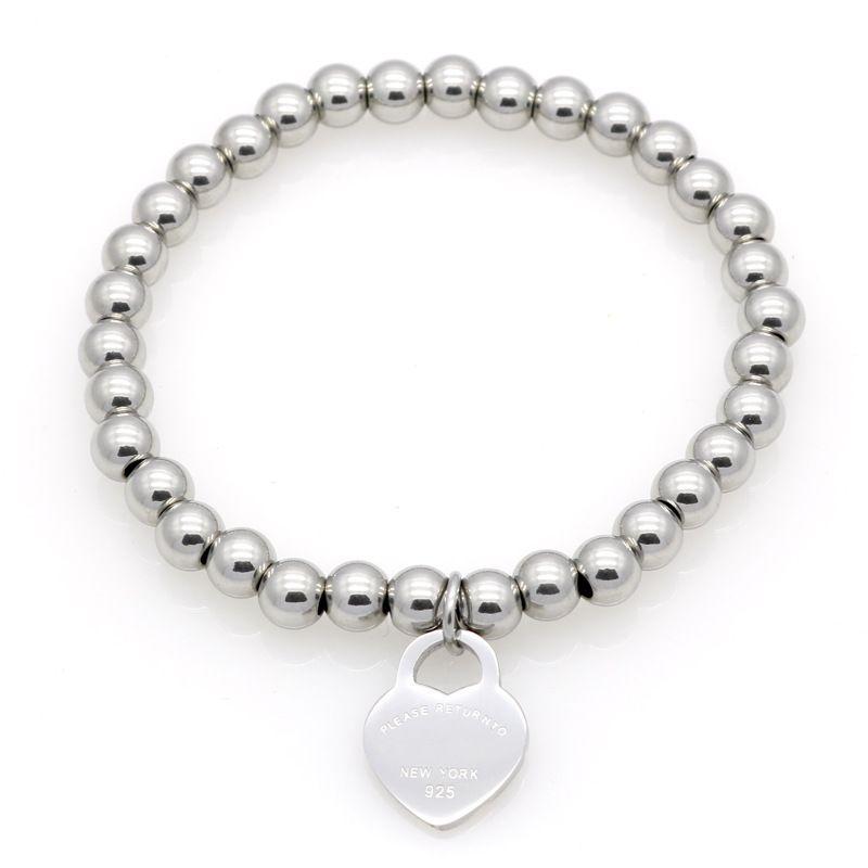 Nouvelles femmes Bracelet en perles de cuivre en acier inoxydable S'il vous plaît retourner à coeur Charmes T Lettre T Lettre Pulsera Bracelet 1PCS Drop Shipping