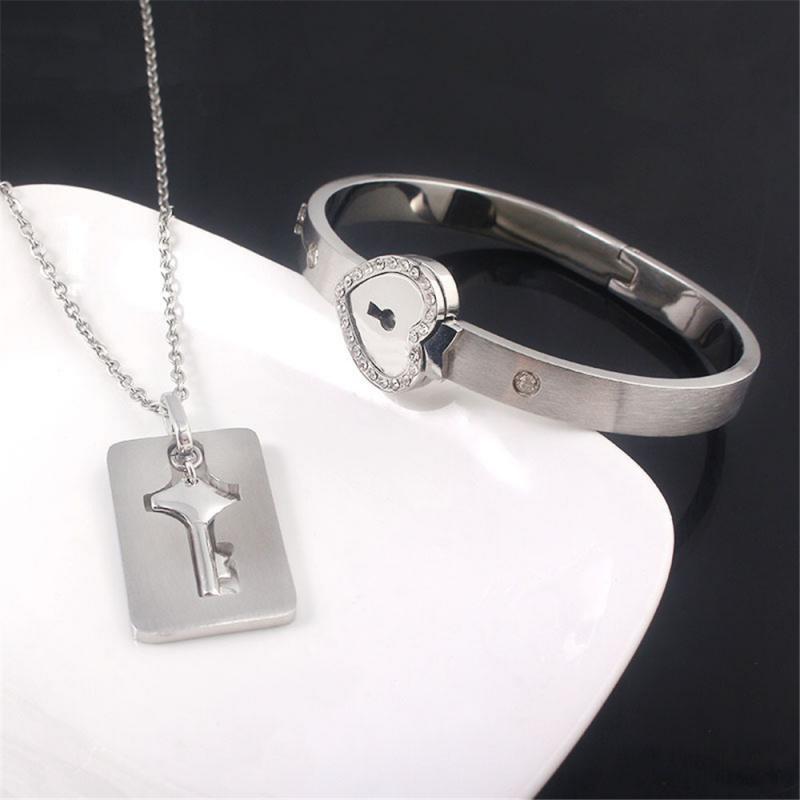 Pareja regalo del día de San Valentín de acero de titanio amor del corazón del melocotón de bloqueo concéntricos bloqueo dominante de la pulsera Kit collar mujeres de los hombres de enclavamiento