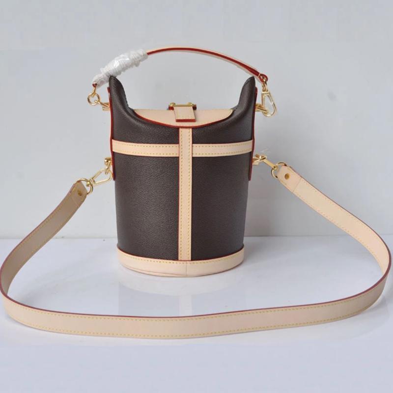 Bolsos de calidad de cuero High Femme Famosa Handle 7a Bandolera Mujeres Barril En forma de Bolsa Top SAC String Bolsines Top Genuine Bucket B OBRD