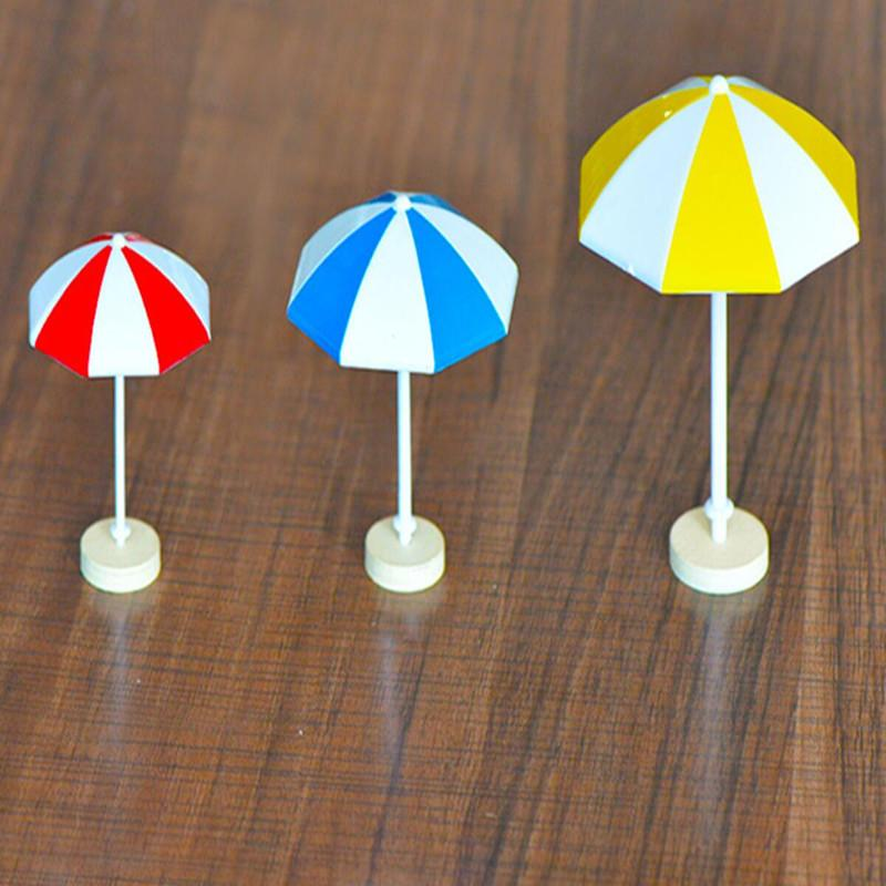 50pcs Beach Sun de la manera Mini Paraguas miniatura del paisaje de PVC casa jardín decoración moderna Accesorios de la muñeca al por mayor