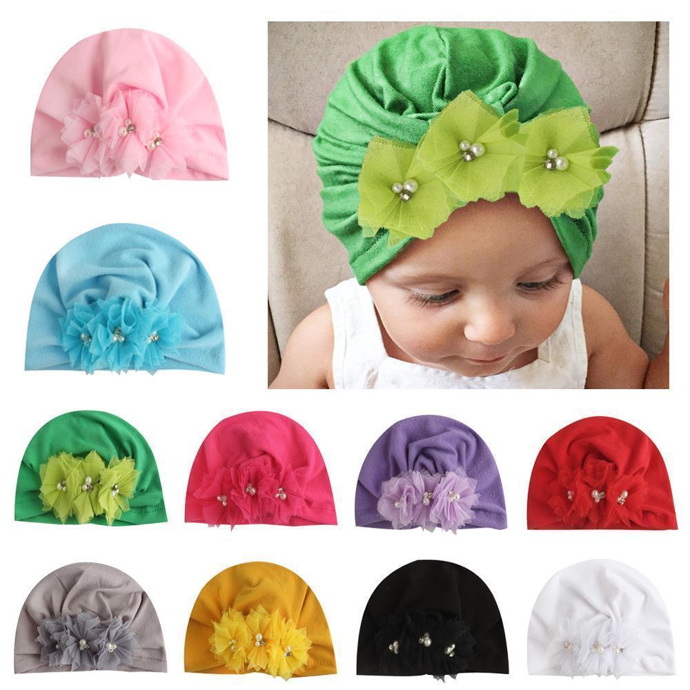 Niedliche Baby-Jungen-Mädchen-Hüte Cotton Net Blumen-Perlen-Turban Verdrehte Beanies Hut Caps für Kleinkind Kinder Neugeborene Kinder Caps