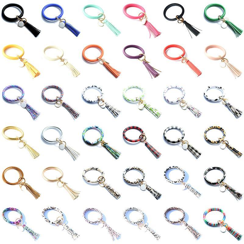 Neue Art und Weise Troddel-Armbänder Schlüsselanhänger PU-Leder-Armband-Schlüssel-Halter-O Schlüsselanhänger Armband Armband Armband Schlüsselanhänger Partei-Bevorzugung Geschenke L625FA
