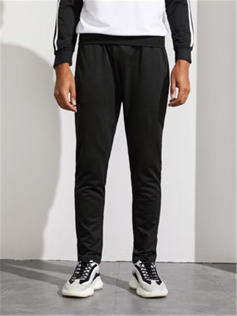 Adam Yan Çizgili Pantolon Moda Trend Patchwork Cep Casual Pantolon Giyim Tasarımcı Erkek Genç Gevşek Spor İpli Pantolon