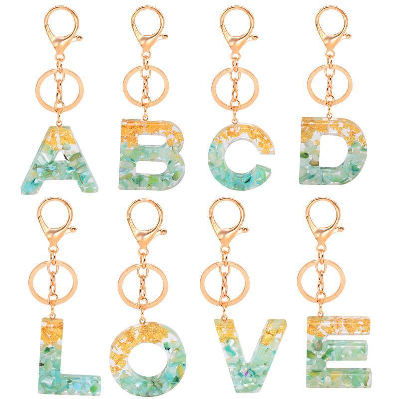 Encantos de la letra Llaveros bolso de la manera inicial 26 alfabetos colgante lindo Llaveros anillo llaves del coche soporte de cinta de acrílico clave de oro Cadenas Accesorios