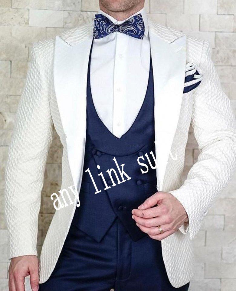Nueva llegada One Button Modelo de marfil Groom Txedos Peak Sapa Groomsmen Trajes de hombre Boda / Prom / Cena Blazer (chaqueta + pantalones + chaleco + corbata) K558