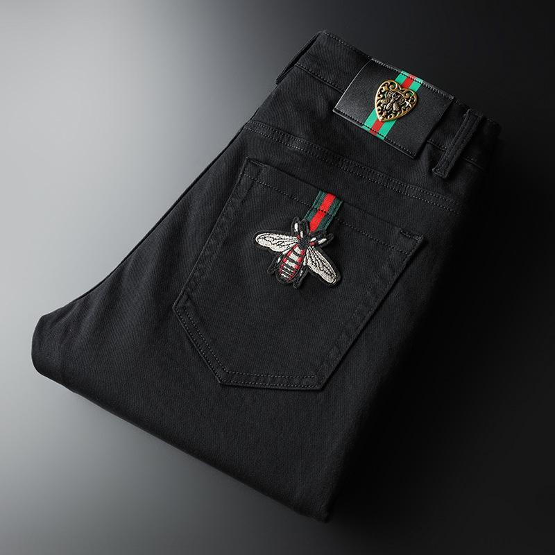 Nueva moda poca jeans y los pantalones vaqueros de los hombres de abejas negras de algodón delgadas del ajuste pequeños pantalones rectos moda skW72