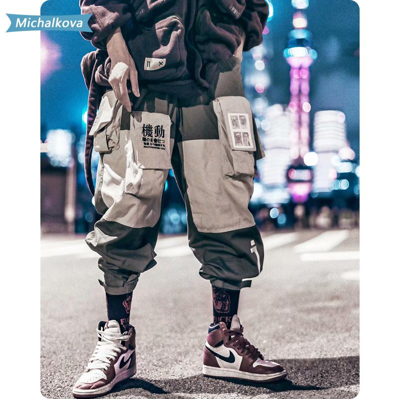 Patchwork Ropa hombre bolsillos de los pantalones del cargo de los hombres de Hip Hop Harajuku Sweatpant masculino Joggers Pista Pantalones Streetwear Michalková 201110