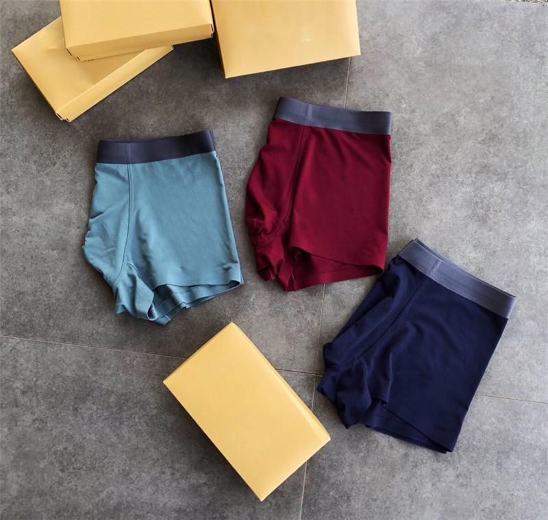 Underwear men sexy underpants nightclub briefs pants new classics pure color letter print panties men middle waist
