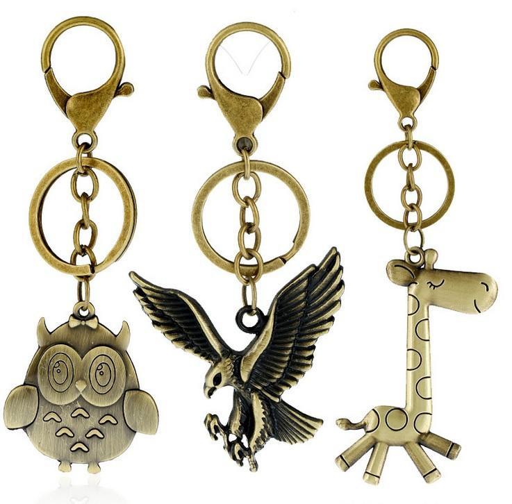 Cartoon Mode-Accessoires Tierkeychain Eule Eagle-Giraffe Soldat-Katze-Anhänger Auto-Schlüssel-Anhänger Schlüsselanhänger Beutel-Anhänger Dekoration
