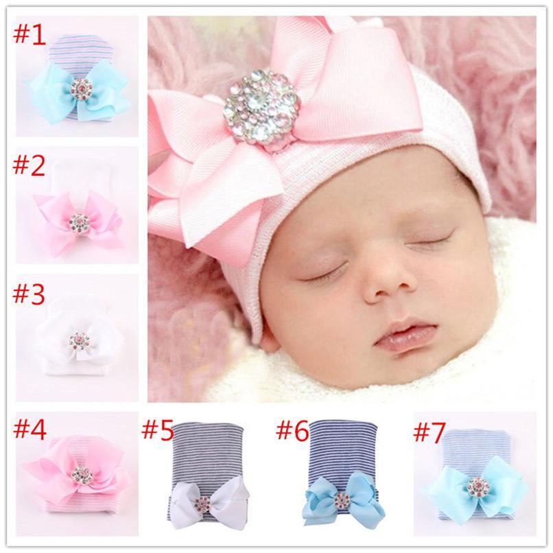 Baby Newborn Winter Knit Hat с большим бантом Алмазные кристалл Heast Hair Party Pailband повязка на голову навязки для волос головные шапочки шапочки череп головные уборы LY1030