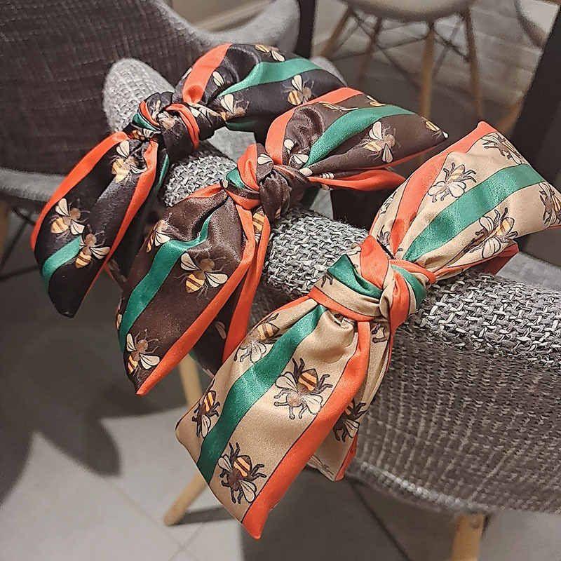 Banda de cabeza a rayas europeas y americanas Pequeñas abejas diademas para damas Todos los accesorios para el cabello de la moda de la moda del partido