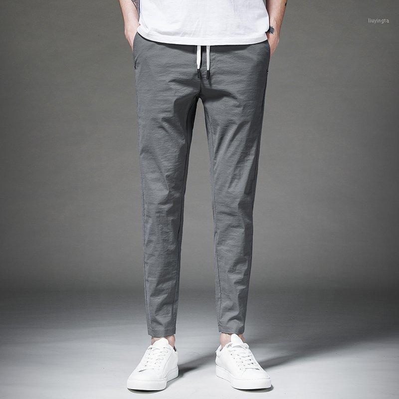Мужские штаны 2021 летние и осенний сезон Тонкий раздел Мода мужская сплошная цветная повседневная 11291