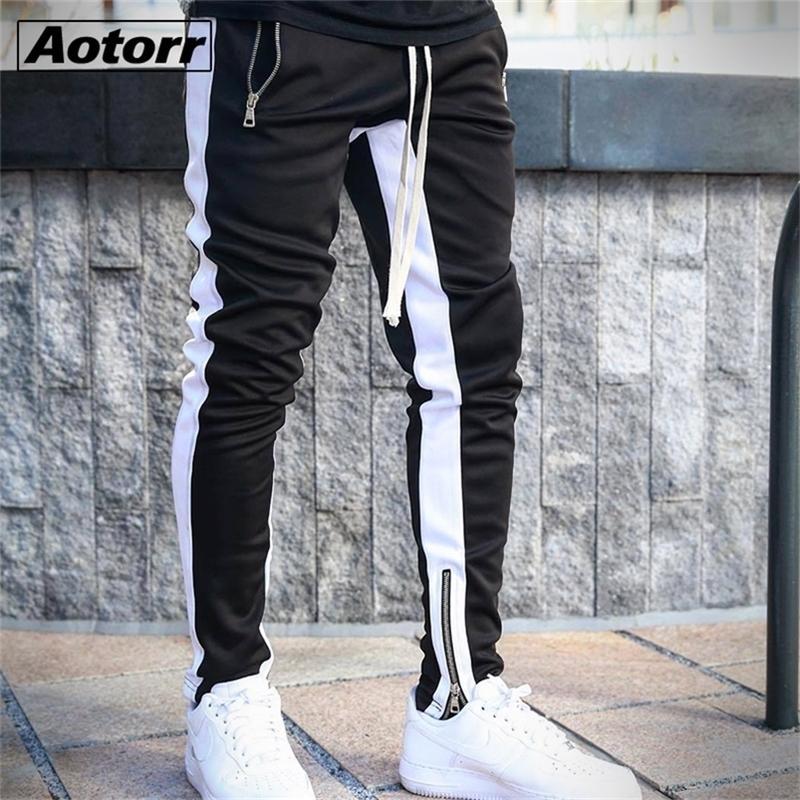 Hombres laterales raya de moda bolsillo casual streetwear jogger pantalón hip hop cremallera fondo masculino lápiz pantalones al aire libre deporte pantalón y201123