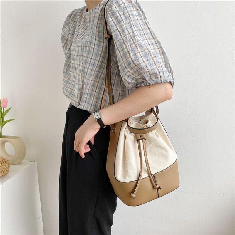 Spalla di personalità Il nuovo modo di disegno delle donne di cucitura della tela Bucket Bag 01-SB-gxbjfb