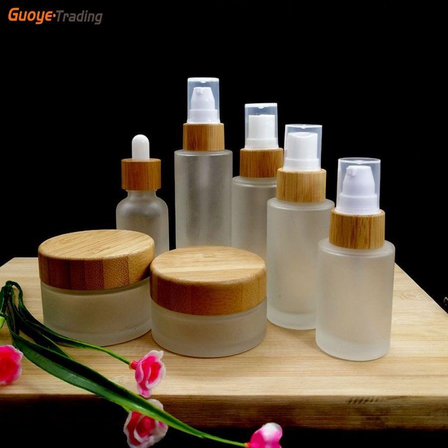 Pakoopie Cosmétique bouteille givrée verre de bambou couvercle cosmétiques fondation Masque d'émulsion masque des yeux Crème de conteneurs de conteneurs de conteneurs ou de pulvérisateur logo et info Print support