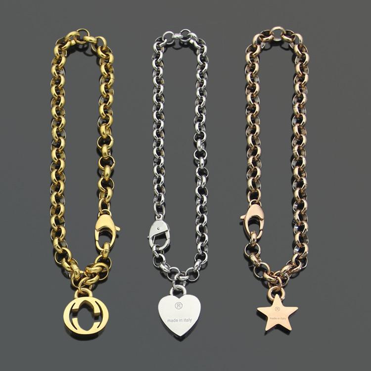 أوروبا أمريكا أزياء نمط الرجال سيدة المرأة التيتانيوم الصلب 18 كيلو الذهب سميكة سلسلة سوار مع g الاولى القلب الخماسي سحر
