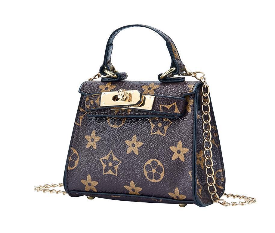 New Kid Kids Handbags Fashion Baby Mini Bolso Bolsos de hombro Totes Adolescente Niños Niñas Mensajero Bolsas Lindos Regalos de Navidad