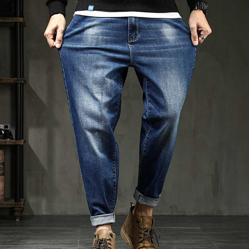 pantalones vaqueros del estiramiento Harem pantalones de mezclilla de los hombres pierden más el tamaño pequeño pies pantalones caen nueva marca joven de alta calidad